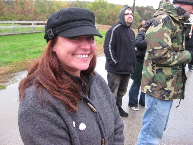 Amy forces a smile, despite the horrendous subjugation at hand