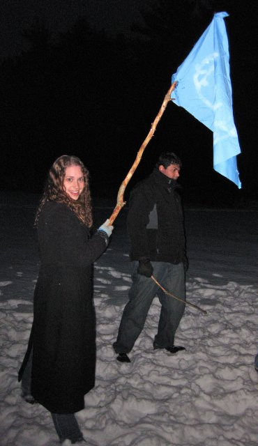 Stephanie Lowers Her Flag Into the Flames